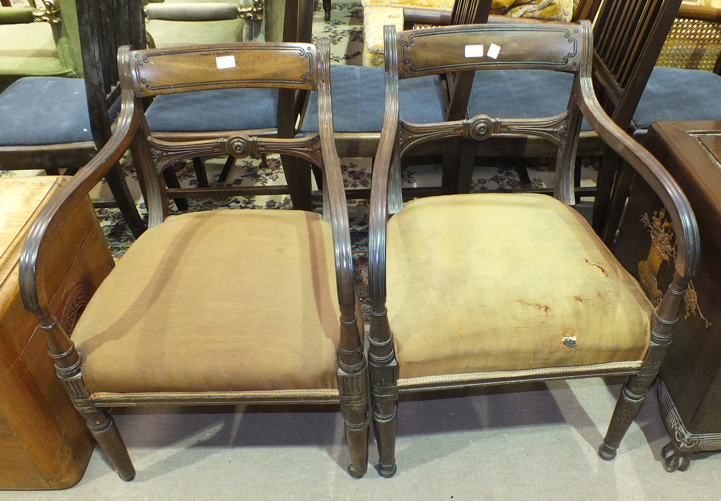 Lot 39 - A pair of Georgian mahogany carver chairs with rail backs and moulded arms, on turned front legs, (
