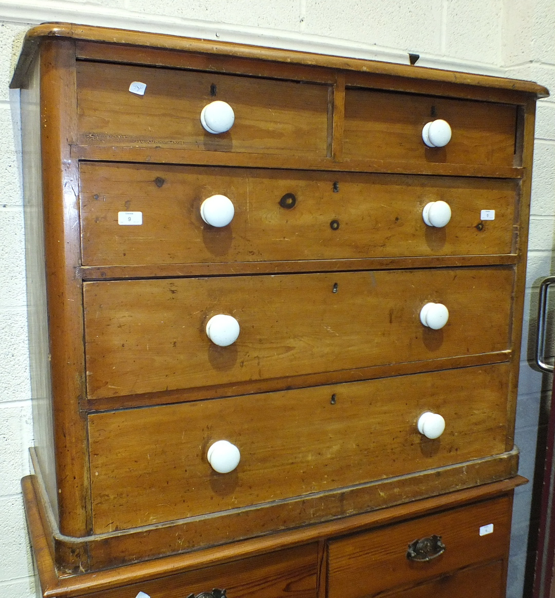 Lot 9 - A Late-Victorian stained pine straight-front chest of two short and three long drawers, with