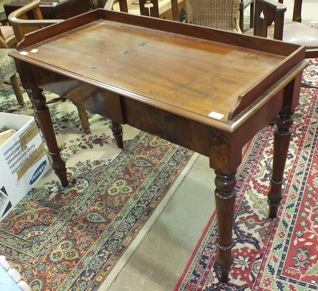 Lot 53 - A Victorian two-drawer side table with galleried rectangular top, on turned legs, 112cm wide.