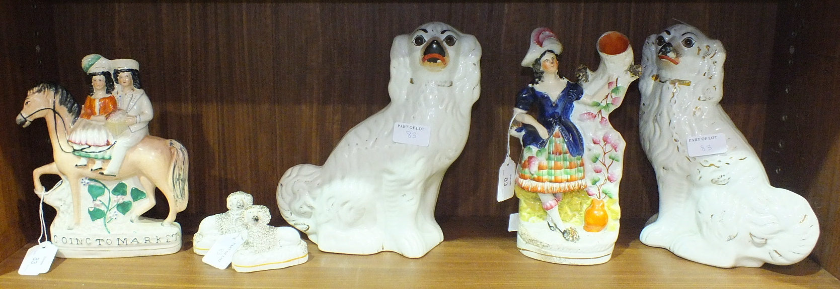 Lot 83 - A Staffordshire flat-back figure 'Going to Market', 21.5cm high, a spill holder in the form of a