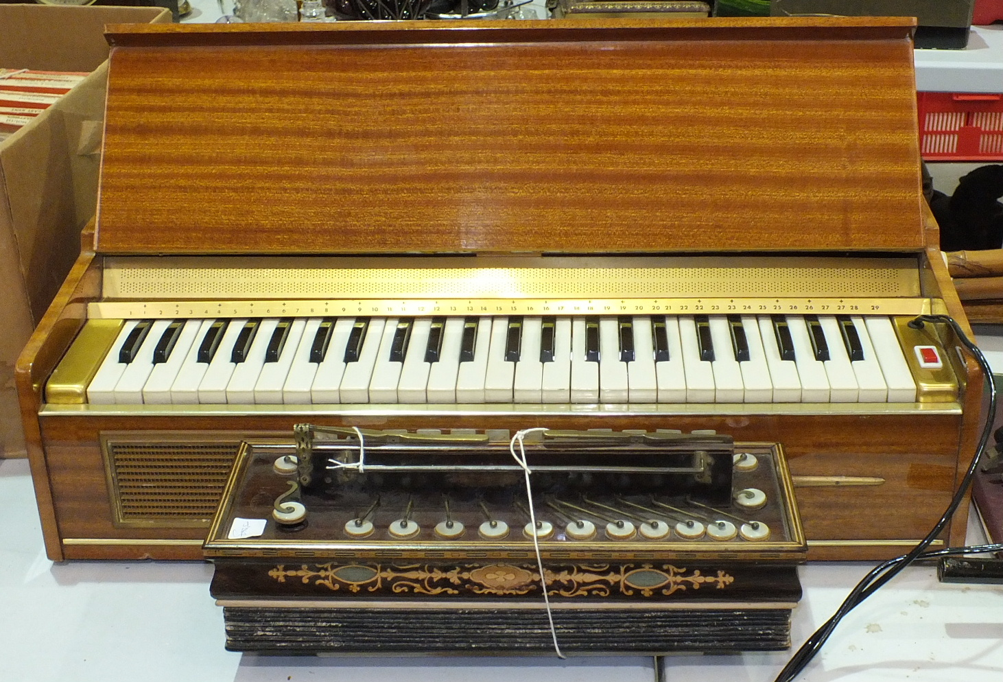 Lot 136 - A Busilacchio electric keyboard, (legs lacking) and a 19th century Busson, Paris, Flutina accordion,