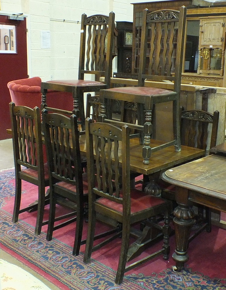 Lot 10 - An oak refectory-style dining table and eight chairs.