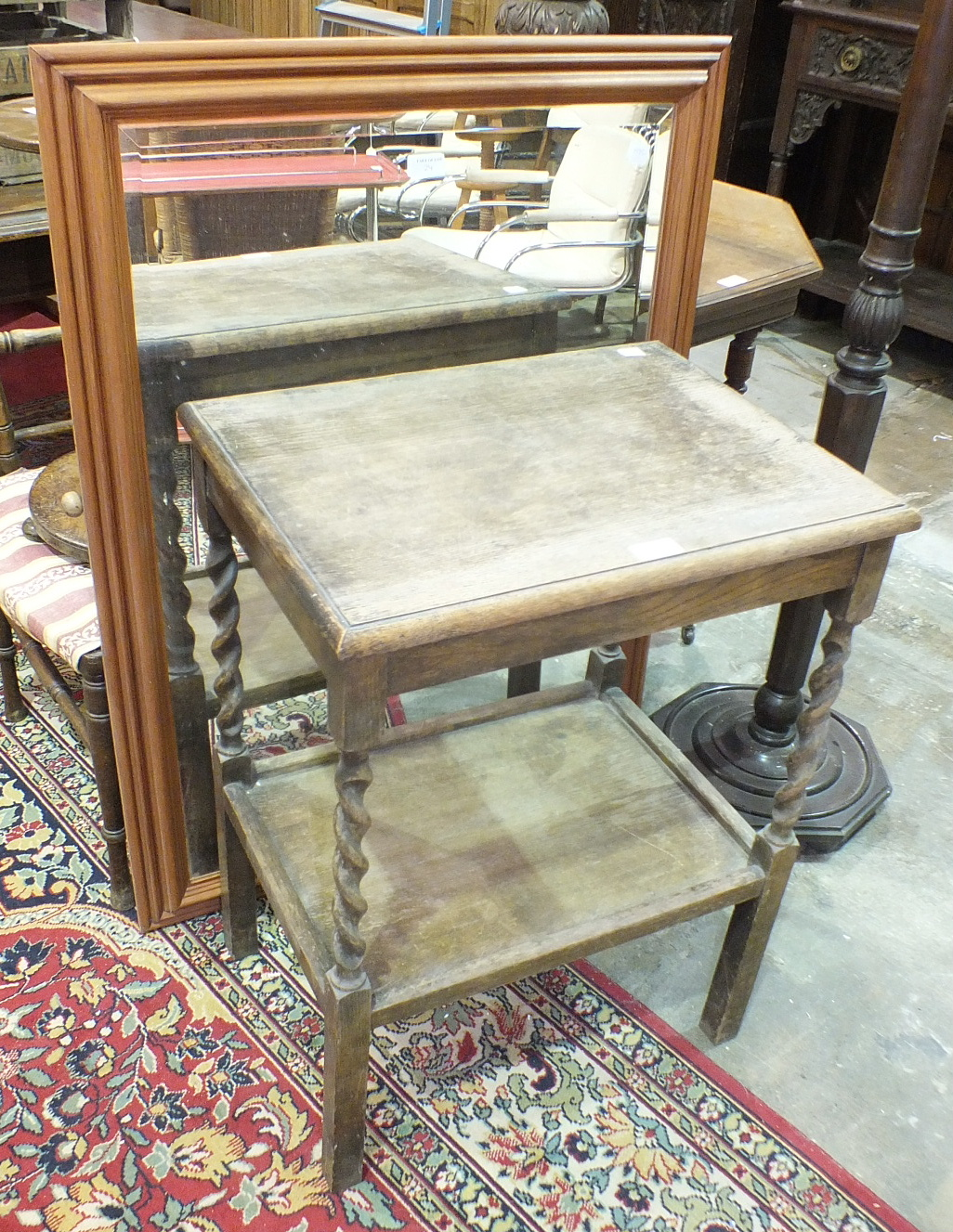Lot 24 - An oak two-tier occasional table, 53 x 41cm and a stained wood standard lamp with turned and