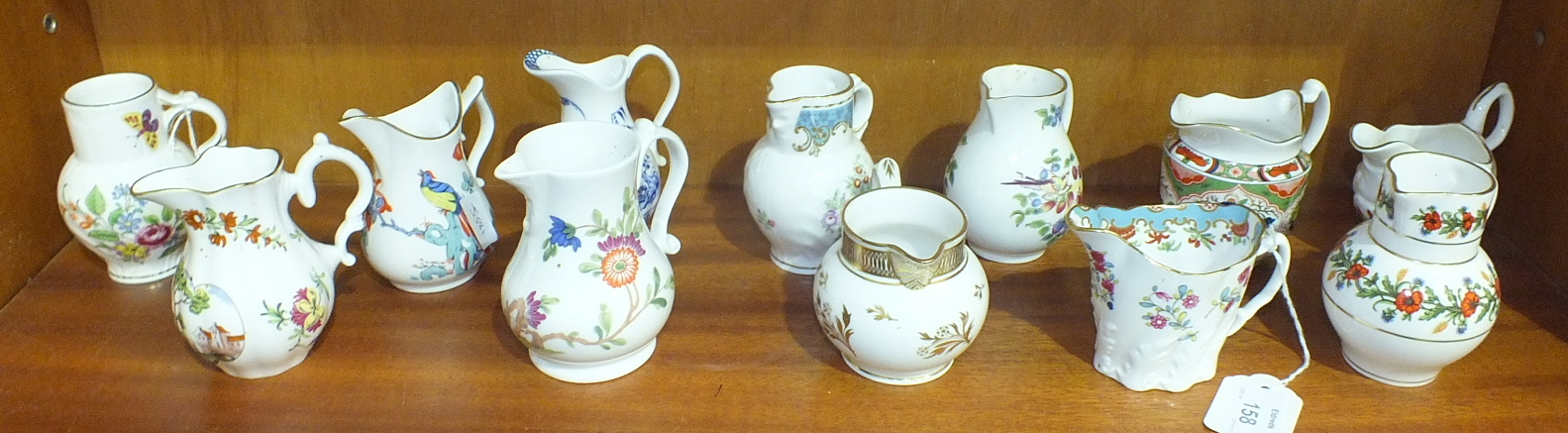 Lot 158 - Twelve Royal Worcester porcelain jugs from the 'Historic Jugs' collection, tallest 9.5cm, (12).