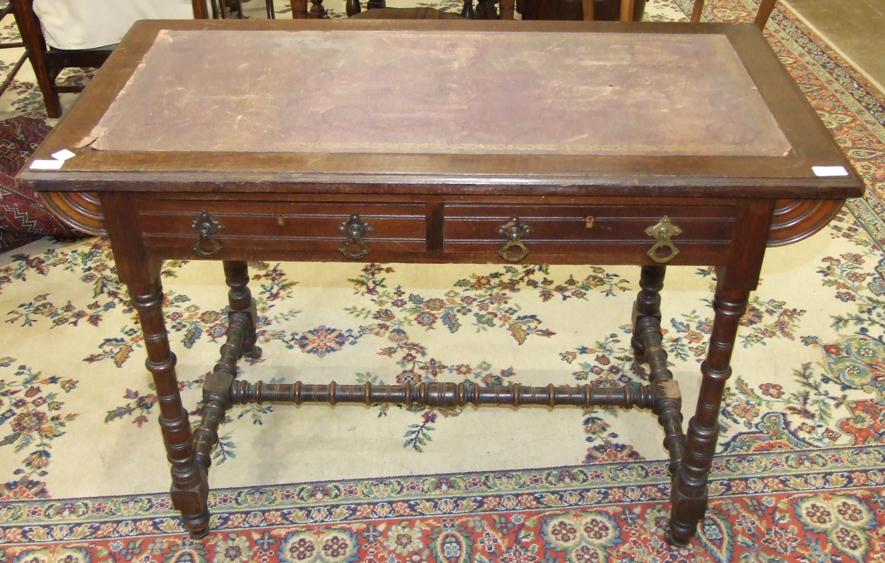 Lot 5 - An Edwardian stained hardwood writing table, the rectangular top with leather inset above two