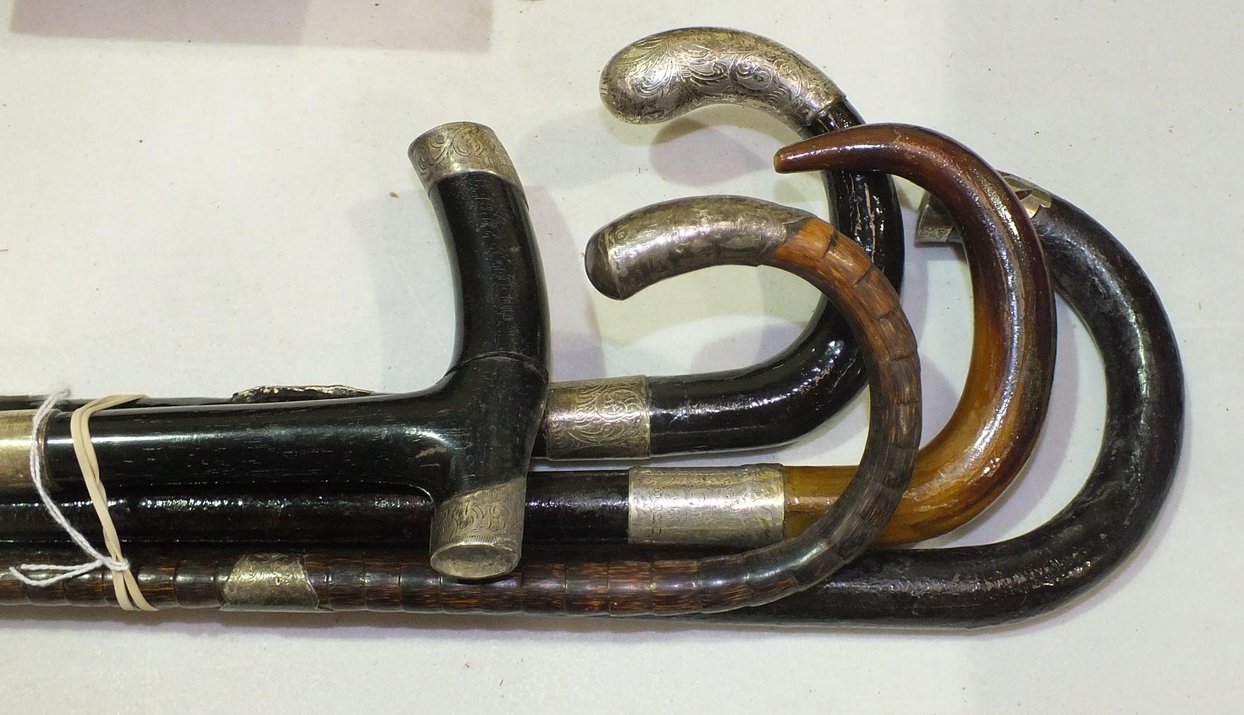 Lot 128 - Five silver-mounted walking sticks, (5).