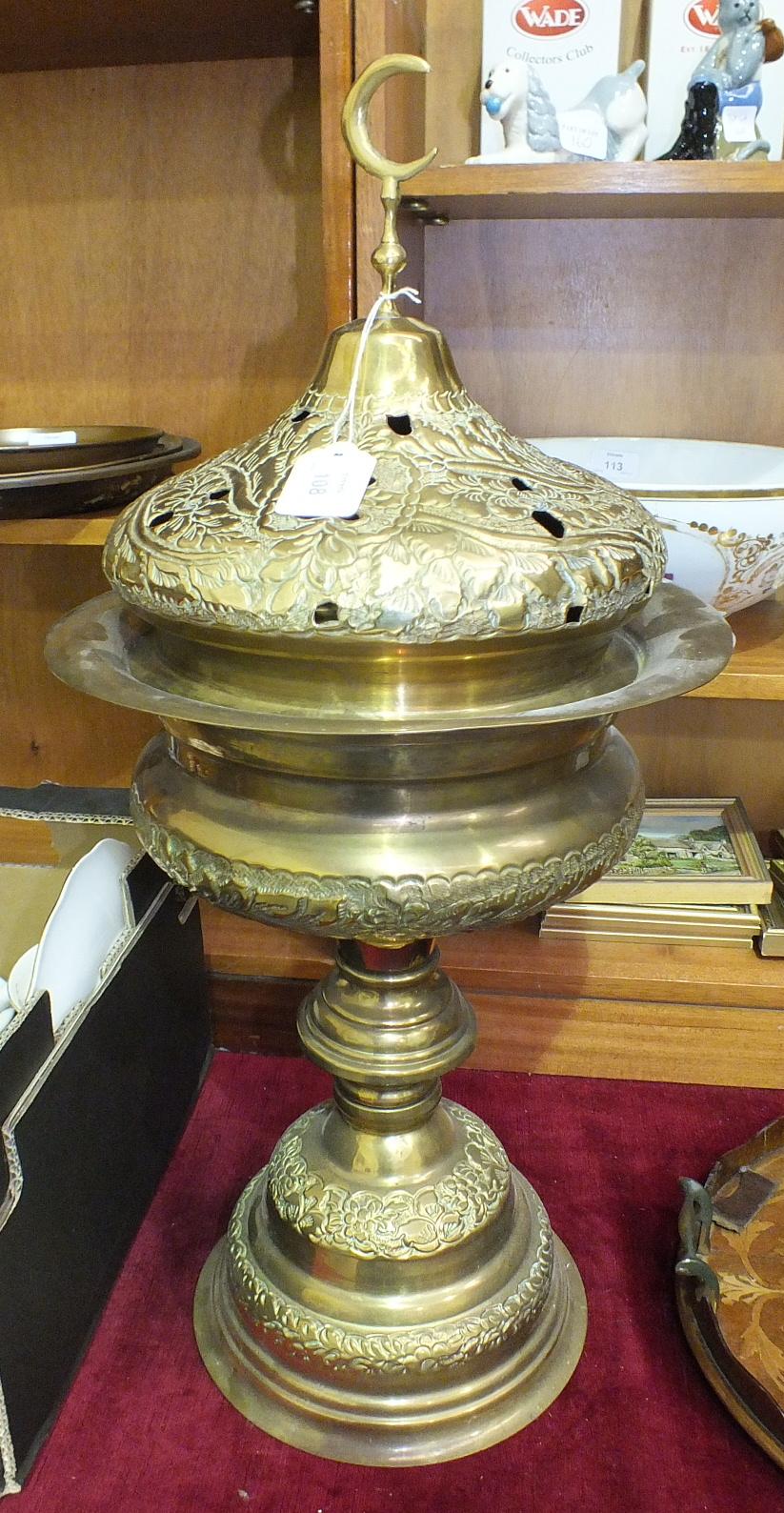 Lot 108 - A pressed brass incense burner, 70cm high.