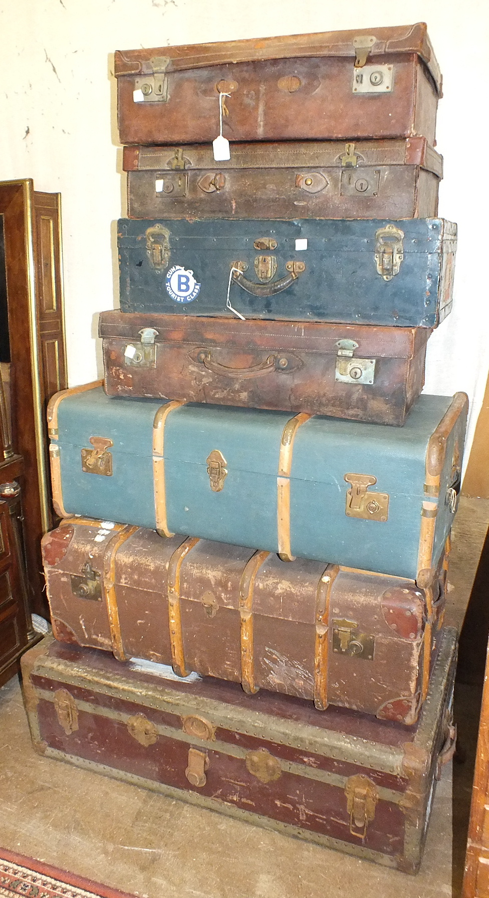 Lot 8 - A collection of luggage, including three leather suitcases and three trunks.