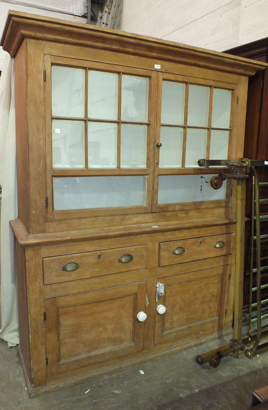 Lot 3 - A late-19th/early-20th century stripped pine dresser, the upper shelved section fitted with a pair