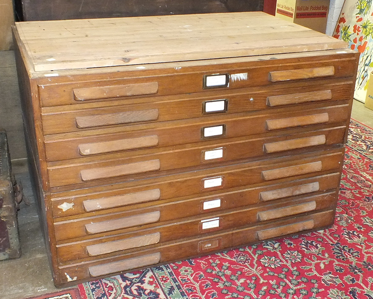 Lot 37 - An early-20th century oak eight-drawer plan chest, 116cm, in two sections.