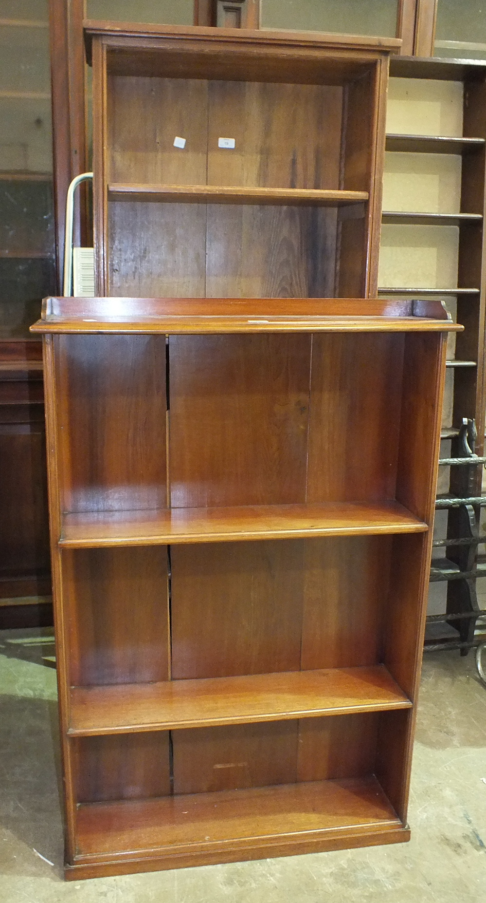 Lot 19 - A set of stained wood bookshelves, 67 x 184cm and a smaller bookcase, 86 x 130cm, (2).
