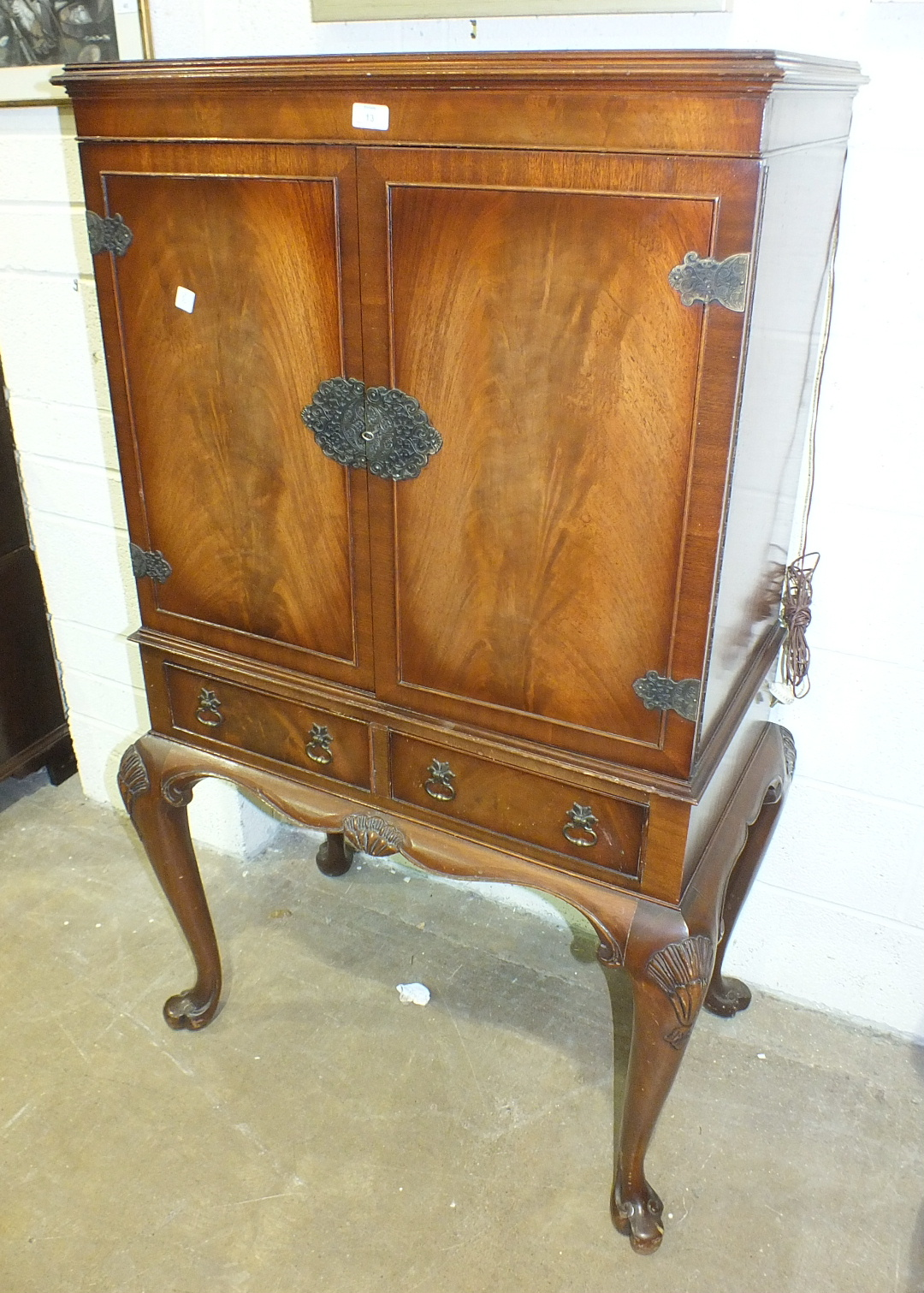 Lot 13 - A walnut drinks cabinet with fitted interior, on cabriole legs and a mahogany side cabinet, (2).