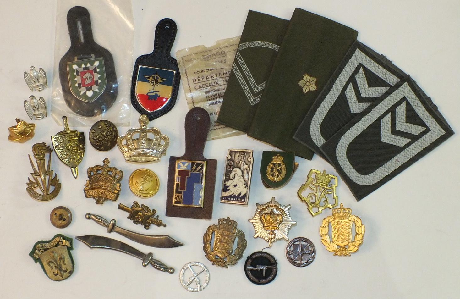 Lot 143 - An enamelled white metal badge for 19ièm Régiment D'Infanterie (France), by Drago, Paris and other