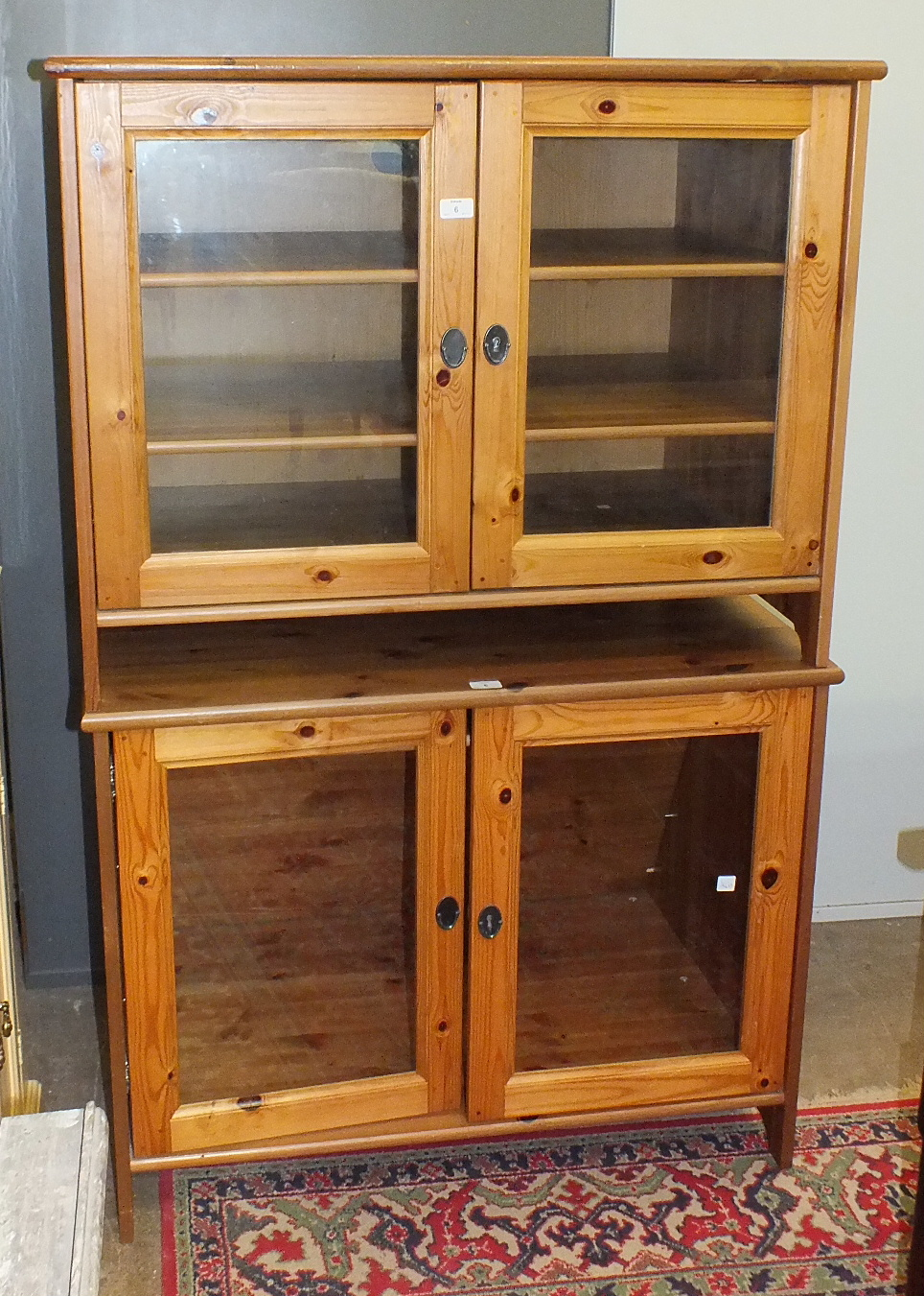 Lot 6 - A pair of modern pine low bookcases fitted with a pair of glazed doors, 95cm wide, 74cm high, (2).