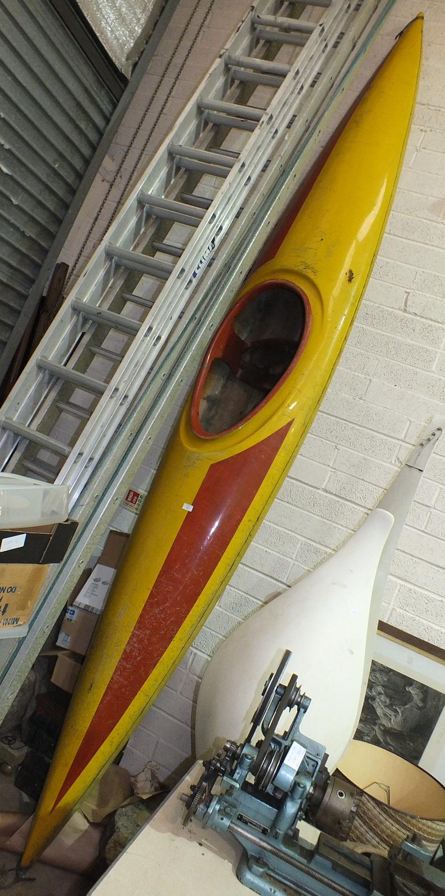 Lot 52 - A fibreglass canoe.