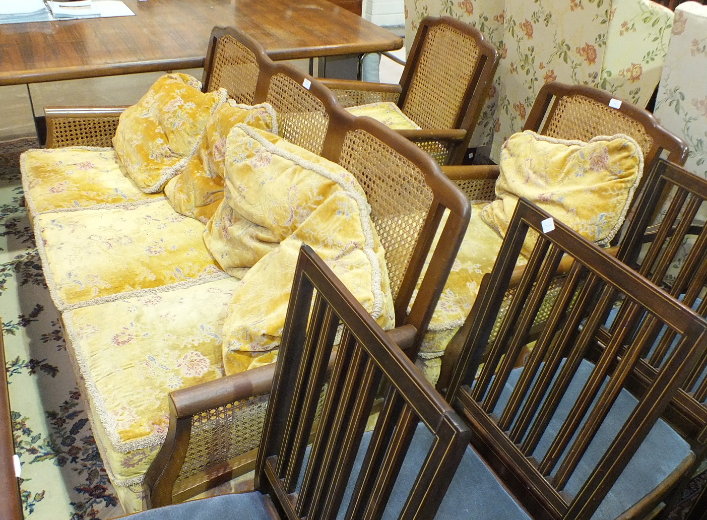 Lot 11 - A walnut and caned Bergère-style settee and two chairs, (3).