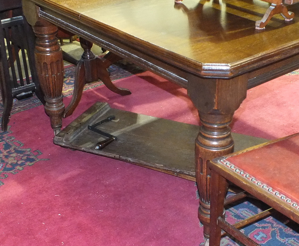 Lot 33 - An early-20th century oak extending dining table on reeded bulbous legs, includes two leaves, 198