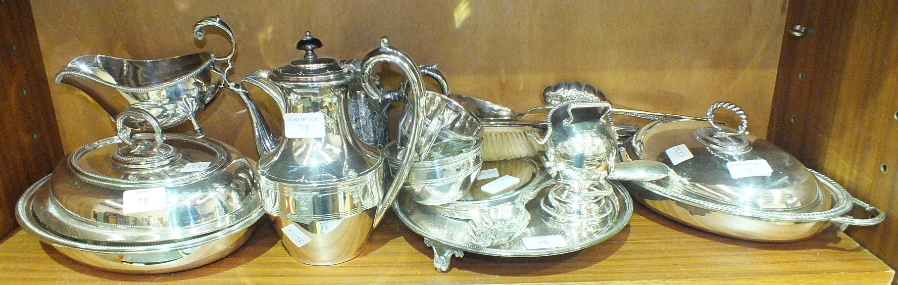 Lot 79 - Two plated entrée dishes and covers, a plated salver, a silver-backed hand mirror and hair brush and