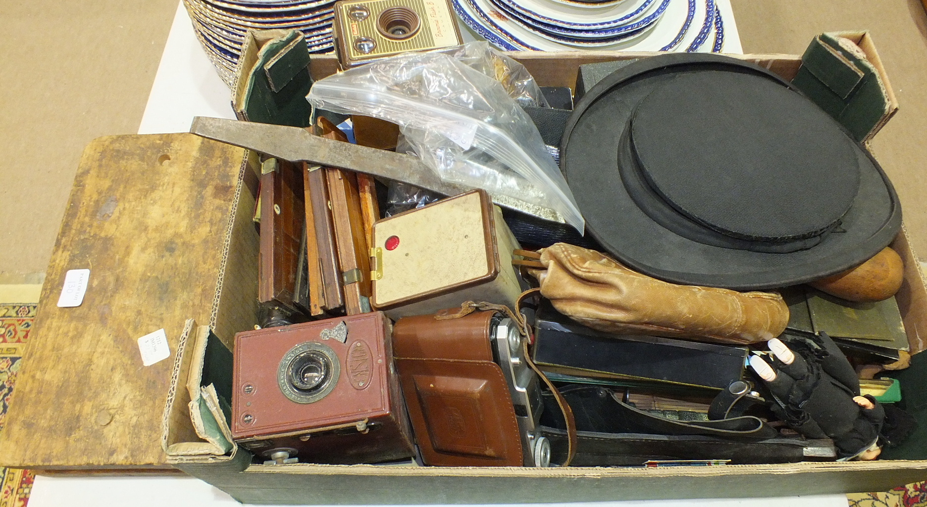 Lot 130 - A folding opera top hat, (in poor condition), a wooden cigar mould and other collectable items.