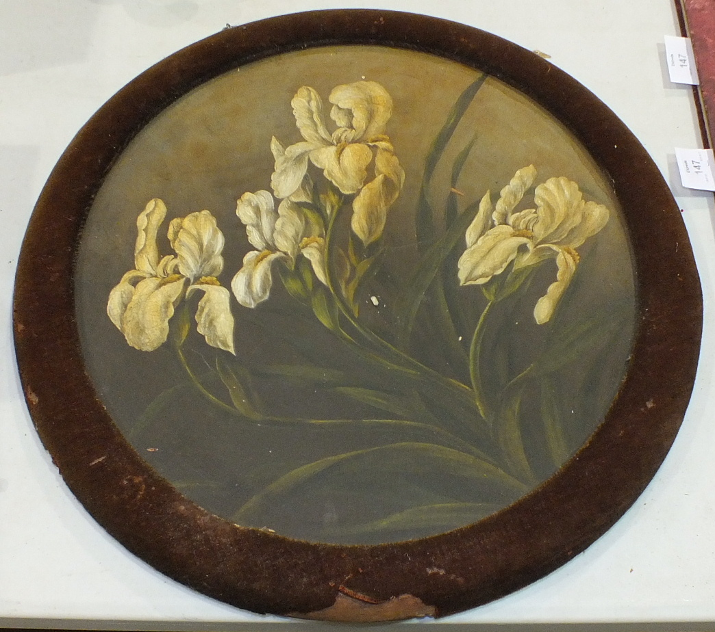 Lot 185 - A large terracotta plate painted with yellow Irises, 40cm diameter, in circular velvet-covered