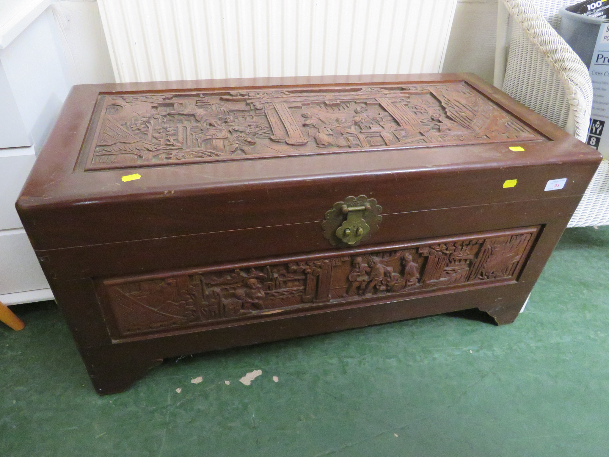 Lot 93 - LIFT-TOP CAMPHOR WOOD CHEST HEAVILY CARVED WITH ORIENTAL SCENES