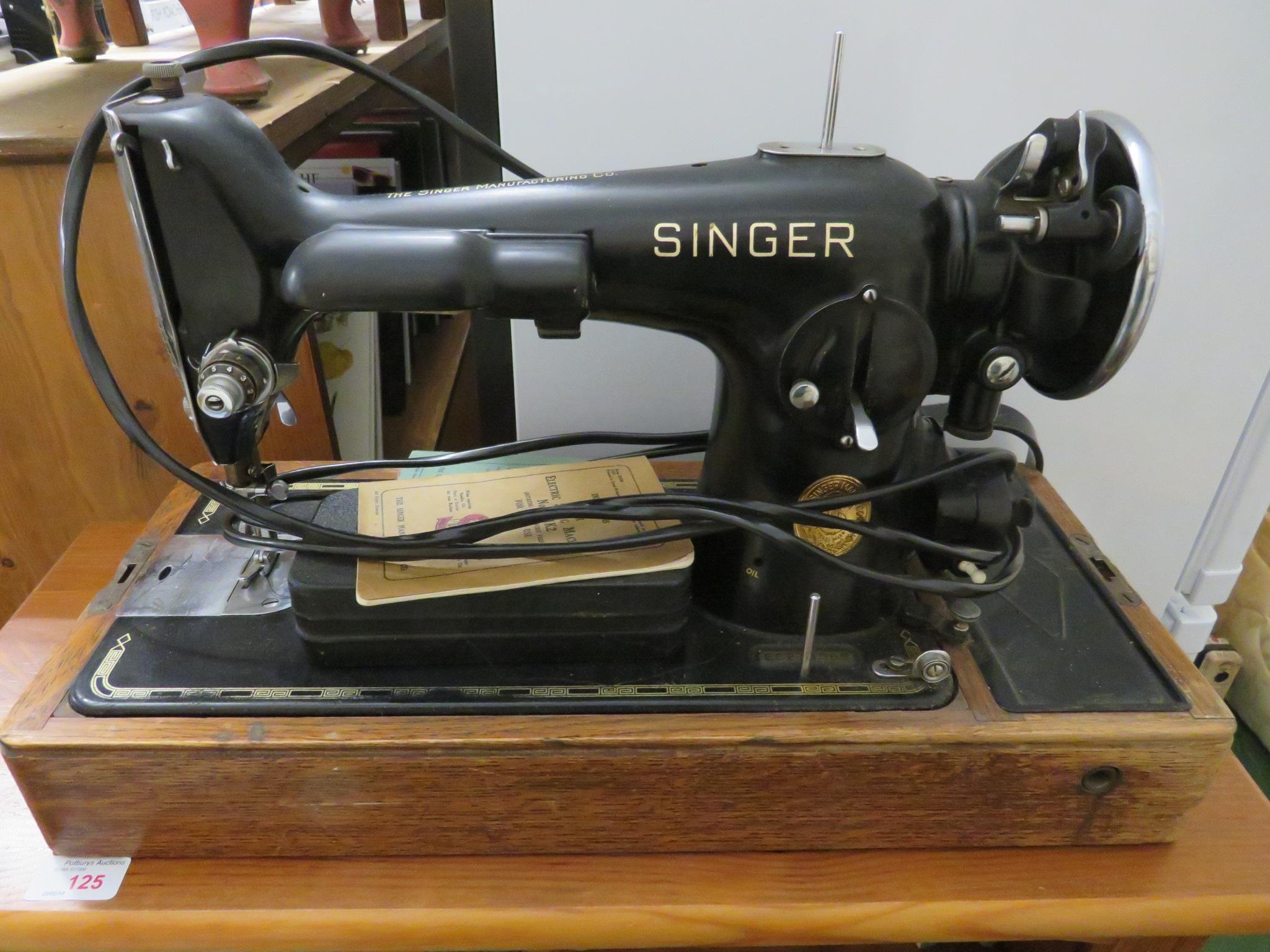 Lot 124 - VINTAGE ELECTRIC SINGER SEWING MACHINE IN WOOD VENEERED CARRY CASE