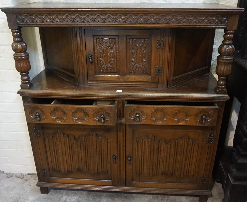 Lot 268 - A Jacobean Style Oak Court Cupboard, circa 20th century, Having a cupboard door to the top,