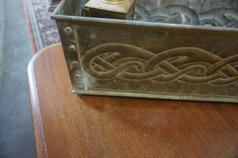 Lot 41 - An Arts & Crafts Brass Planter, Decorated with allover Celtic knotwork panels, with ring handles,