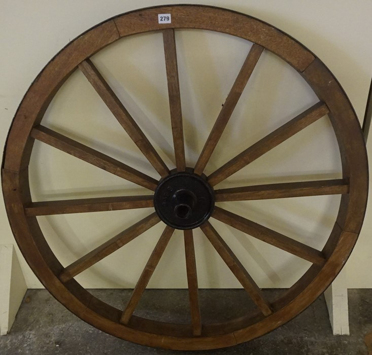 Lot 279 - A Large Wooden and Metal Bound Cart Wheel, 103cm diameter