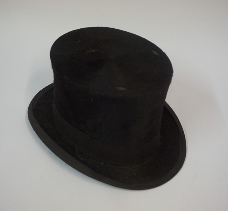 Lot 96 - A Vintage Black Top Hat, Stamped to interior for Christy,s London, internal dimensions 19.5cm x