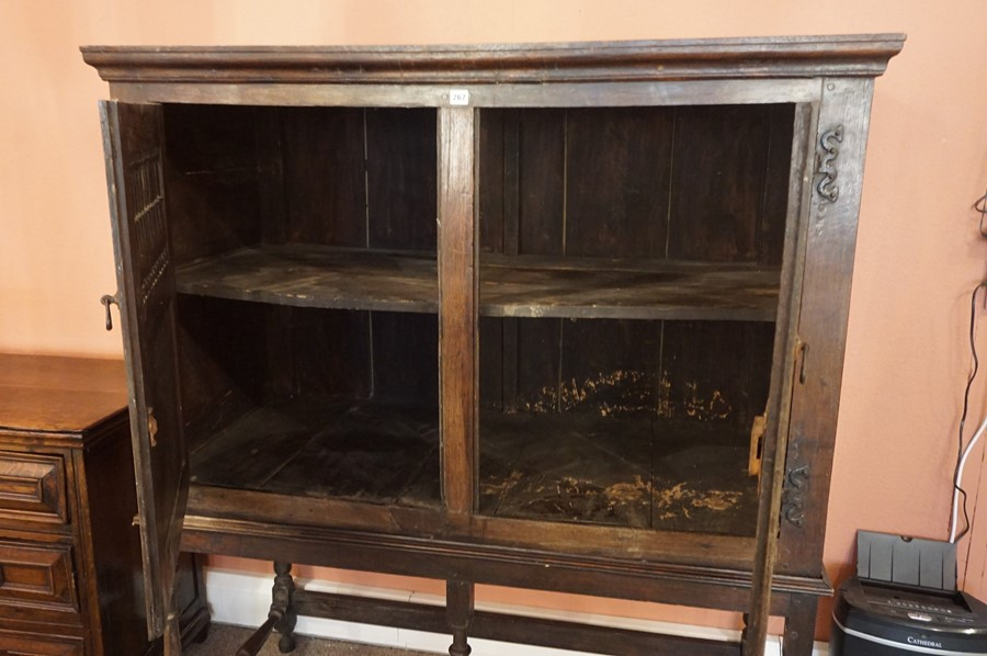Lot 267 - An Oak Dole Cupboard on Stand, circa 17th century and later, Having two balustrade decorated