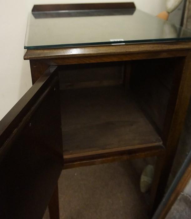 Lot 318 - A Vintage Mahogany Pot Cupboard, Having a panelled door, 73cm high, 44cm wide, 44cm deep