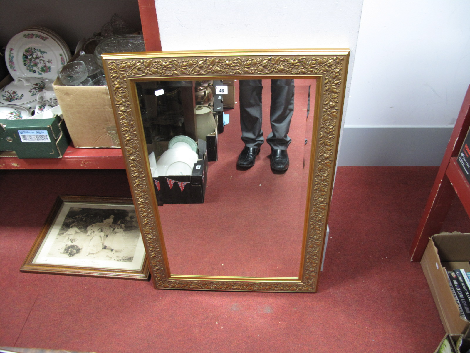 Lot 46 - A Rectangular Gold Coloured Framed Wall Mirror by Tivoli, approximately 94 x 65cm. A sepia print '