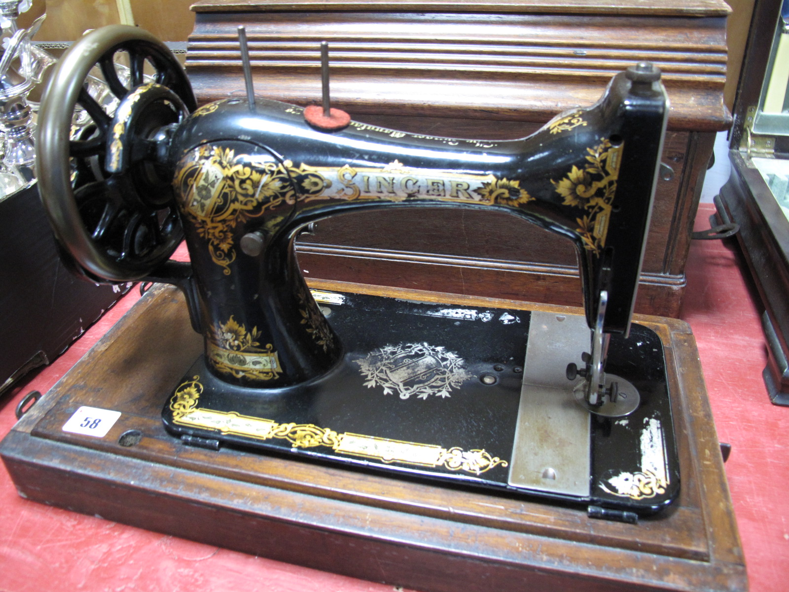 Lot 58 - A Late XIX Century Singer Sewing Machine, (cased).