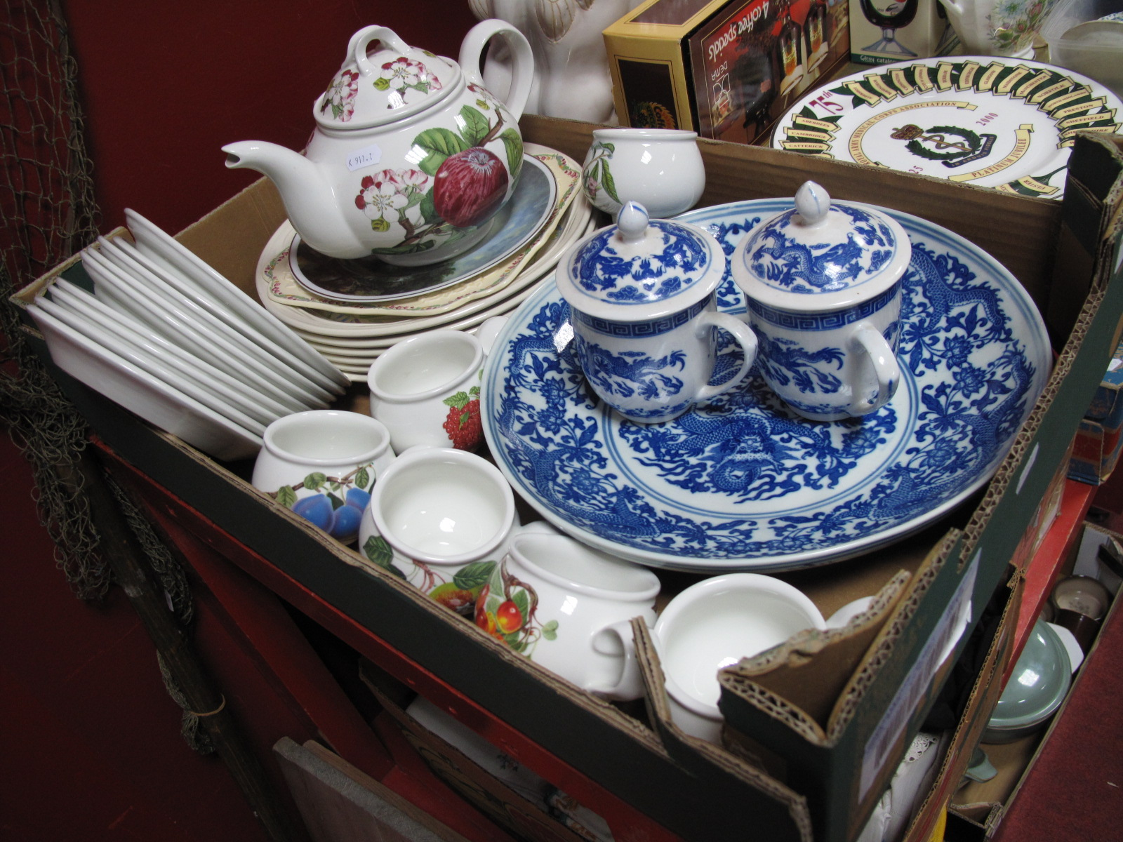 Lot 1 - A Portmeirion 'Pomona' Teapot, six matching teacups, side plates and 18.5cm diameter dished