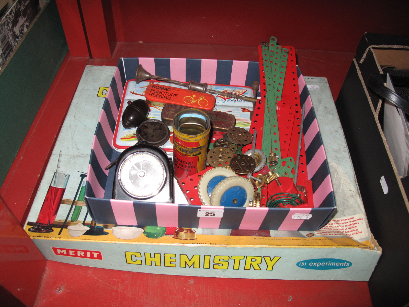 Lot 25 - A Small Quantity of Vintage Meccano, Smith's/Johnson Bakelite timer, vintage cycle repair kits,