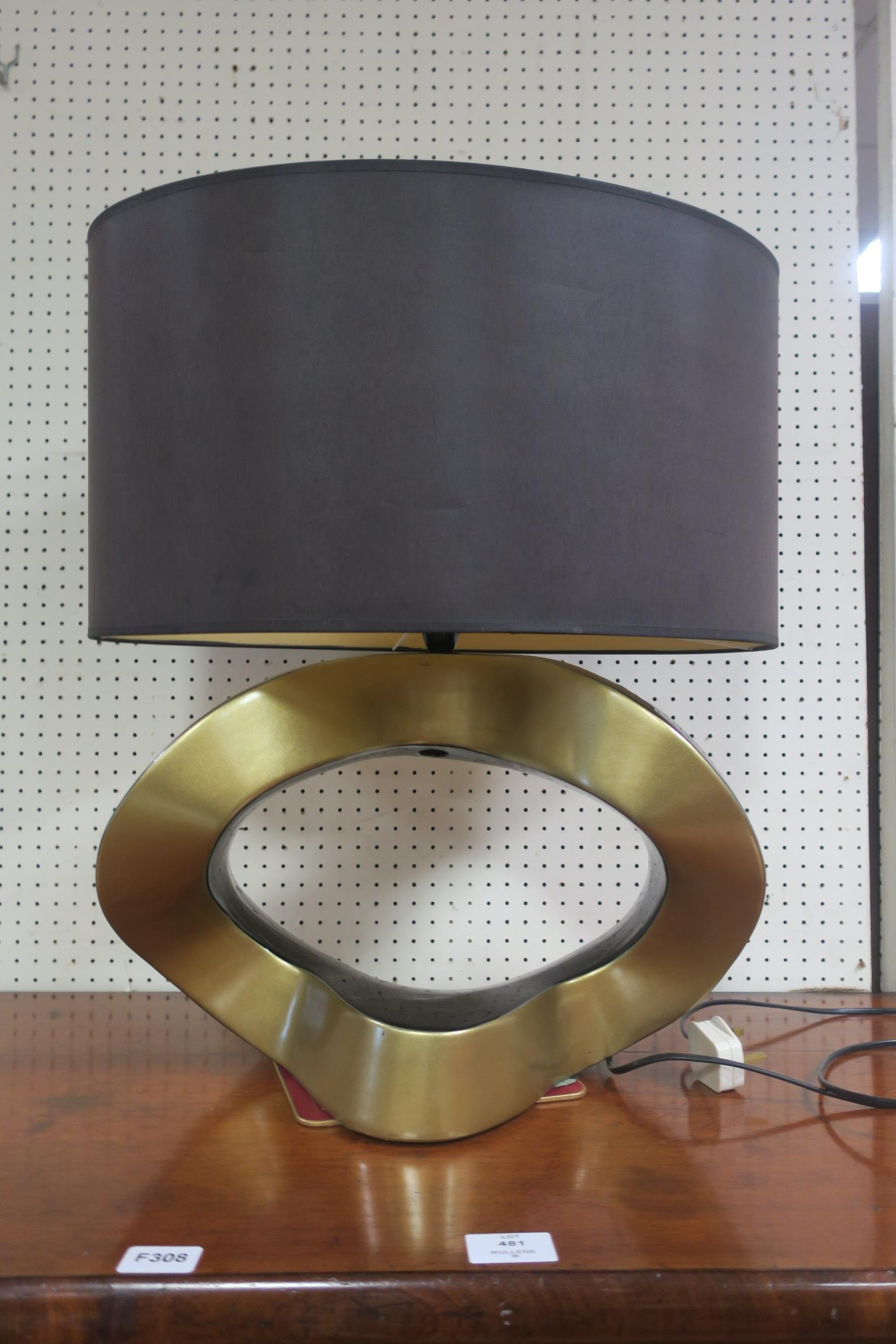 Lot 482 - A BLACK LACQUERED AND GILT TABLE LAMP,