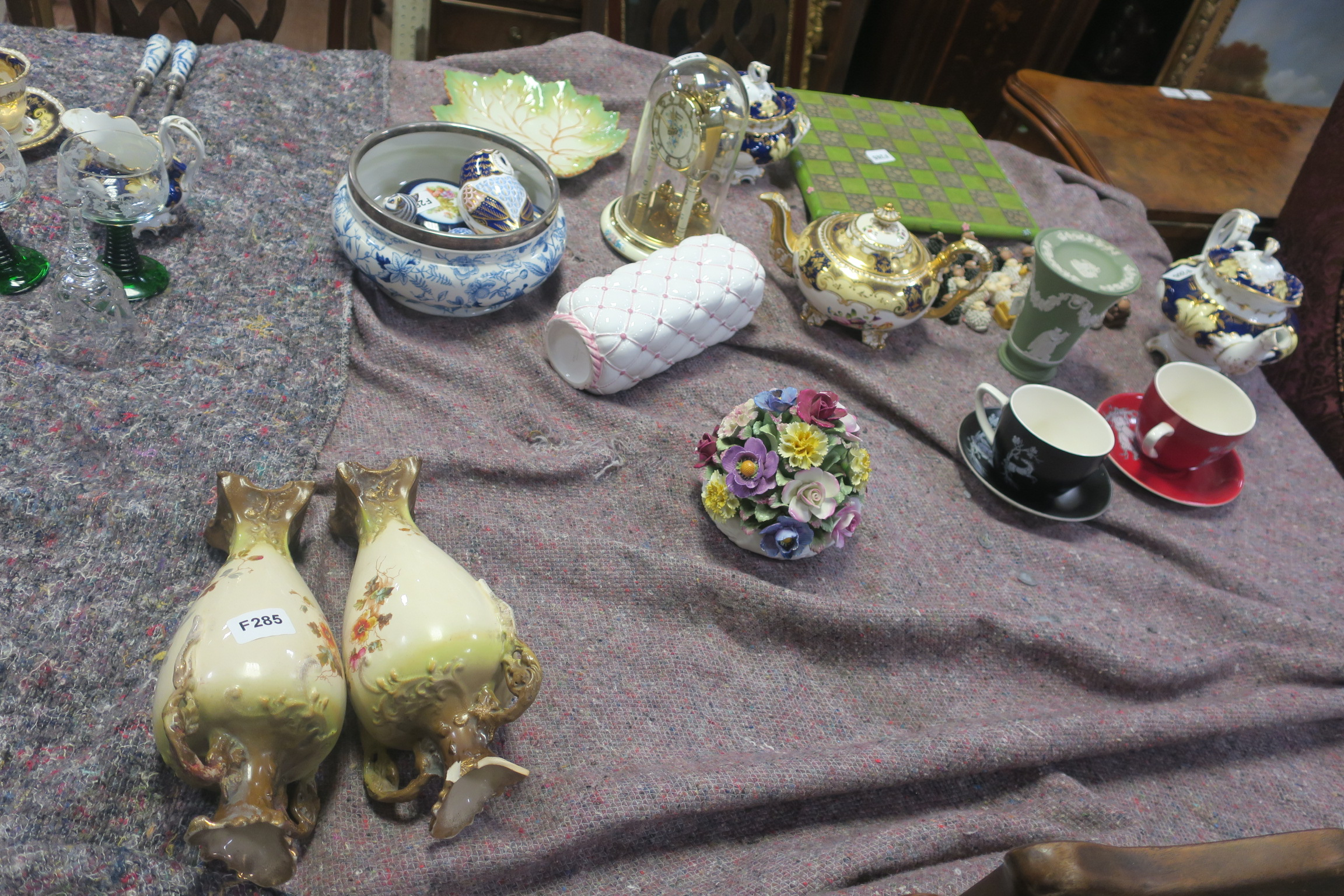 Lot 327 - A MISCELLANEOUS COLLECTION, on four shelves to include Wedgewood vase, a Belleek vase,