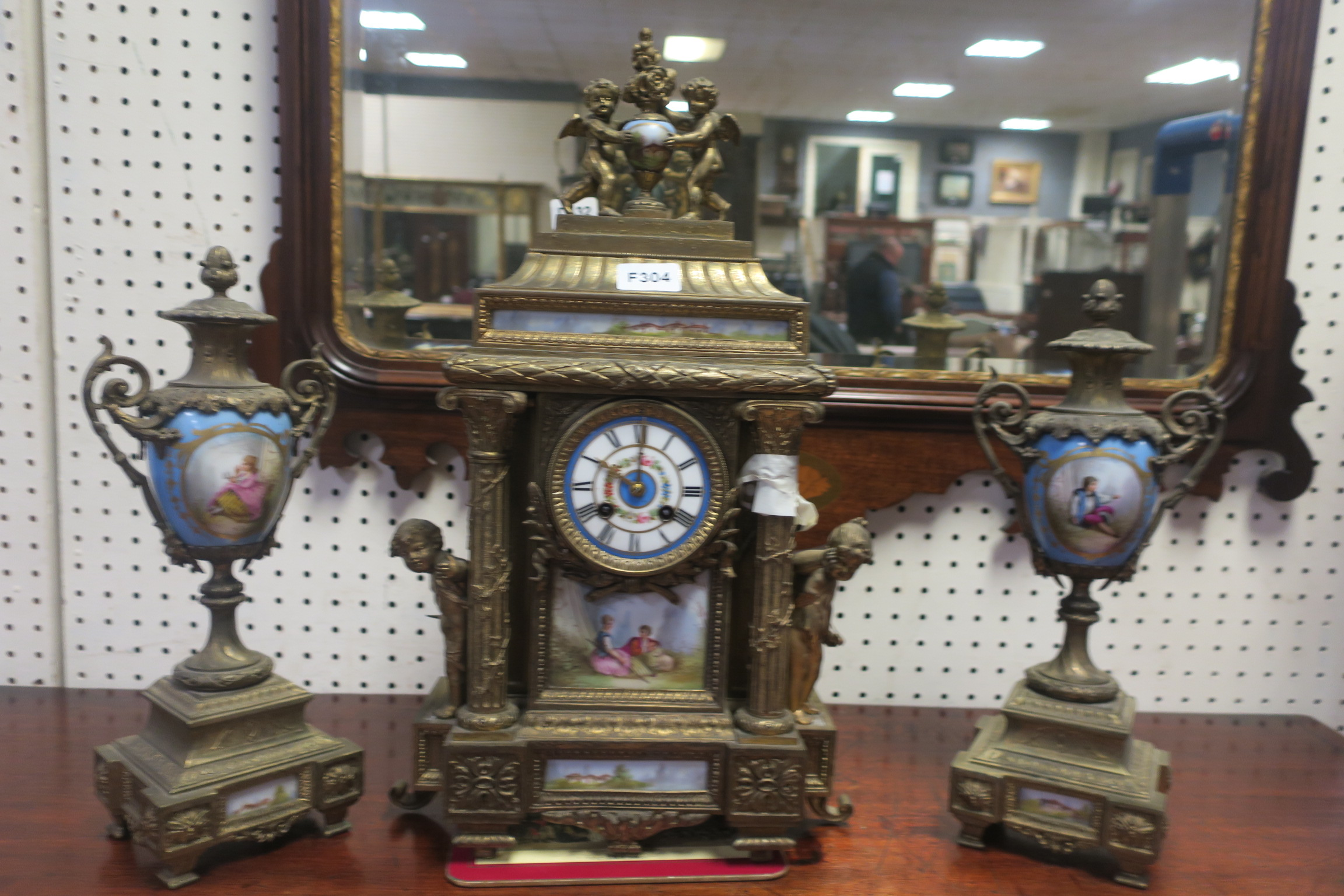 A 19th CENTURY GILT METAL AND PORCELAIN CLOCK GARNITURE,
