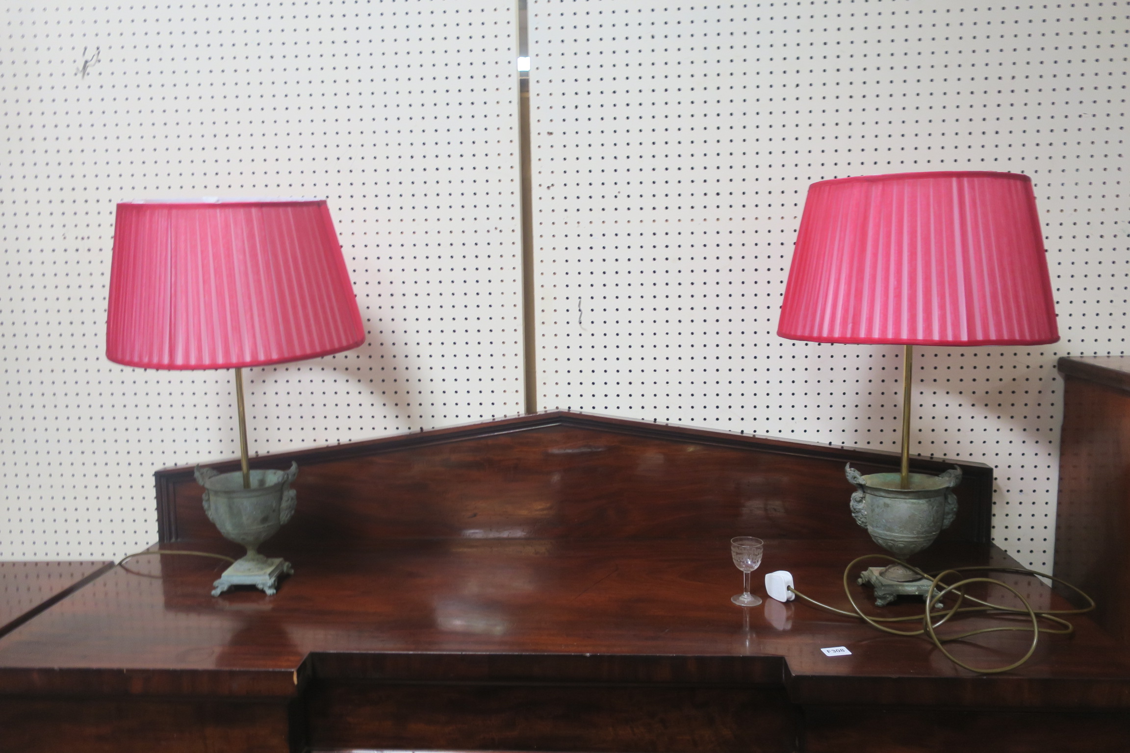 Lot 382 - A PAIR OF HEAVY BRONZE TABLE LAMPS each of urn form cast with figural masks above rectangular base