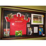 Manchester United treble winners, 1999 shirt and display, 72-1/2in w x 43-1/2in hgt red repilca