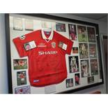 A limited edition Manchester United 1999 Champions League Winners jersey signed by 20 Manchester