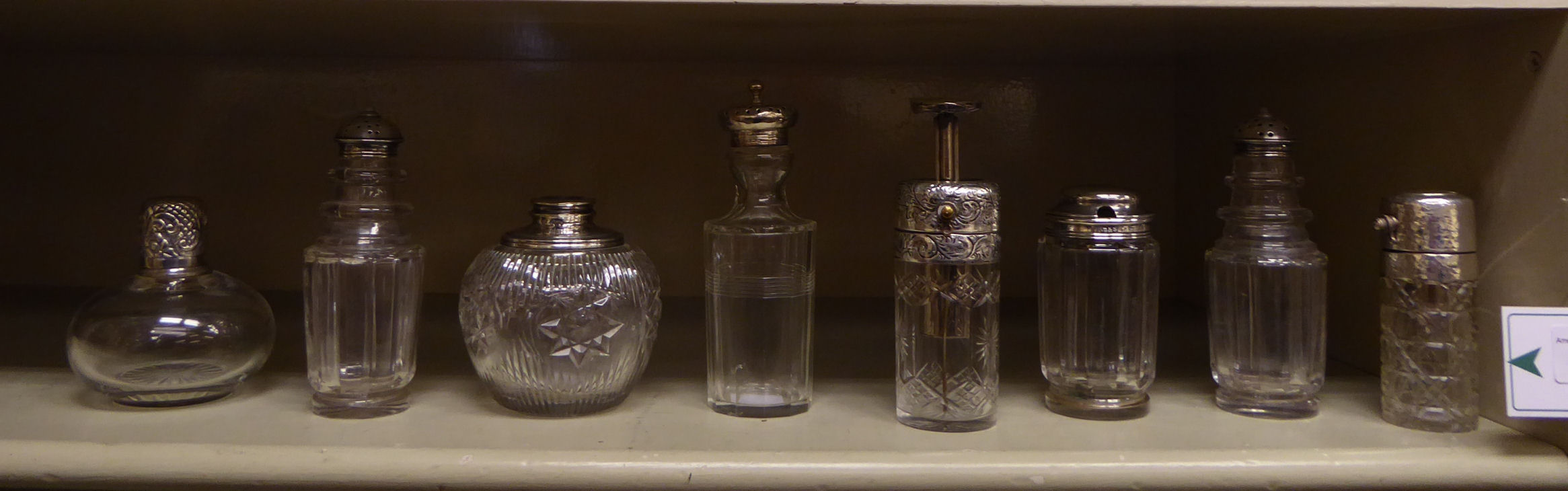 Lot 41 - Eight 19thC and later silver capped dressing table scent bottles mixed marks OS1
