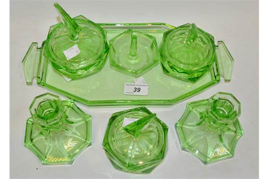 An Art Deco green glass dressing table set comprising of ...