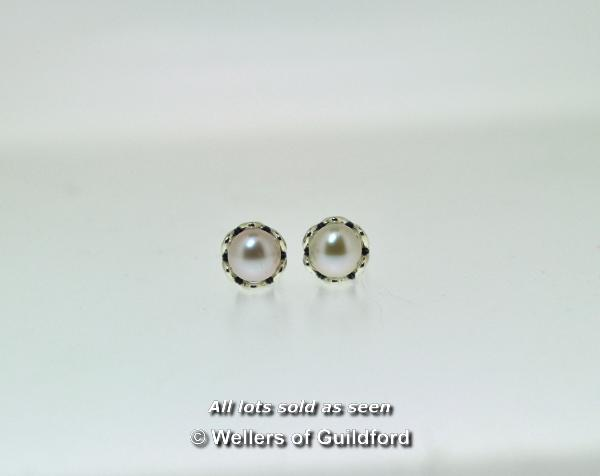 Lot 7062 - *Pair of Pandora pearl stud earrings in silver (Lot subject to VAT)