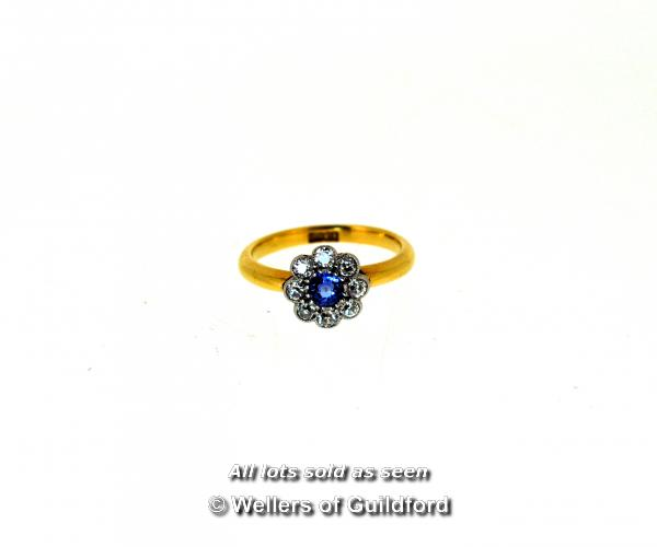 Sapphire and diamond cluster ring, central round cut sapphire with a a surround of eight old cut