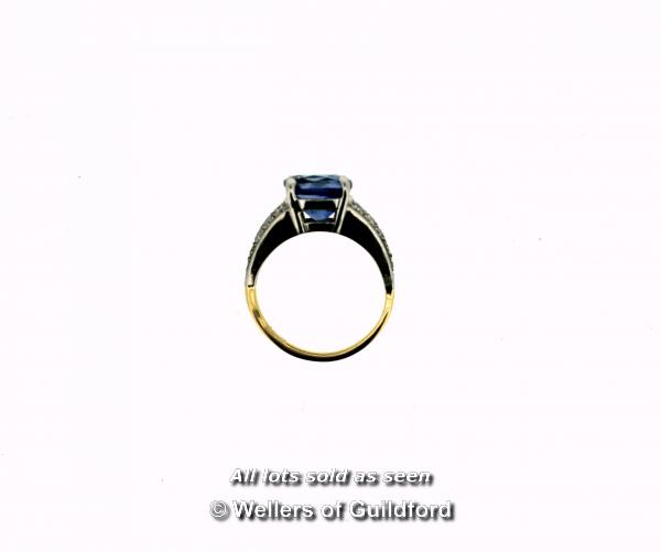 Lot 7004 - Sapphire and diamond ring, central cushion cut blue sapphire weighing an estimated 3.00cts, four