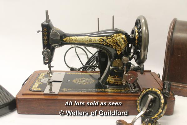 Lot 7270 - A vintage Singer sewing machine serial number P960799, with added sewing machine motor and case