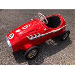 A rare Pines Monza pedal race car C1960s. Finely detailed plastic body measuring 108cm in length.