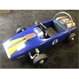 A Lola pedal race car C1960s. Finely detailed metal body measuring 116cm in length.